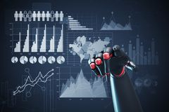 Red and black robot hand, graphs. Close up of a black and red robot hand pointing at the viewer. Dark blue background with graphs and infographics. 3d rendering Royalty Free Stock Photo
