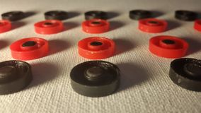 red and black round figures on a white canvas royalty free stock images