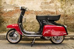 Red black scooter. A red-black scooter newly painted Royalty Free Stock Images