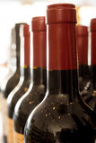 Red and Black Sealed Wine Bottle Necks Royalty Free Stock Photos