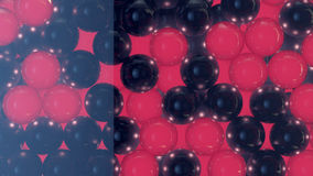 Red and black shiny spheres stacked in a glass container Royalty Free Stock Images