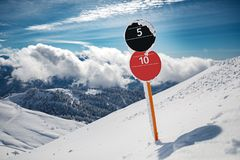 Red and black slopes number sign at mountains royalty free stock image