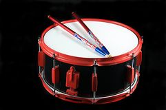Red and Black Snare Drum. A red trimmed snare drum isolated on black background in the horizontal format with copy space Royalty Free Stock Photo