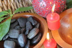 Red and black spa concept. With rocks and candles Royalty Free Stock Photo