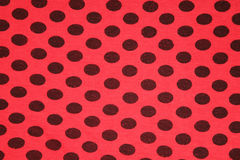 Red with black spots textile texture Royalty Free Stock Images