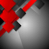 Red and black squares on metallic perforated Stock Photos