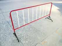 Red and black steel fence on concrete road. Temporary red and black steel mobile fence on concrete road Royalty Free Stock Photography