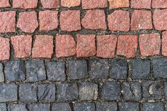 Red and black stones. Road surface royalty free stock images