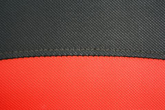 Red and black Synthetic leather. Closeup red and black Synthetic leather texture Royalty Free Stock Image