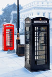 Red and black telephone boxes. Traditional red and black telephone boxes in London city. UK Royalty Free Stock Photography