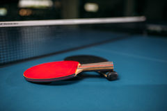 Red and black tennis rackets on table game concept Royalty Free Stock Photos
