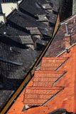 Red And Black Tile House Roof. Old Town rooftops abstract architecture, contrasting two halves composition, Bratislava city, Slovakia Royalty Free Stock Photos