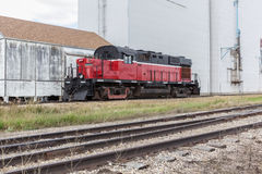Red and black train. Oraked on the tracks Royalty Free Stock Image