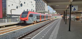 Red and black train on station Gouda a light rail train between alphen and gouda in the Netherlands. Red and black train on station Gouda a light rail train royalty free stock image
