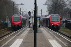 Red and black train on station Waddinxveen of R-NET, a light rail train between alphen and gouda. In the Netherlands stock images
