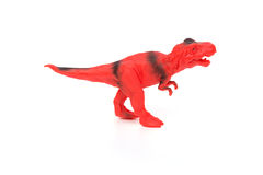Red and black tyrannosaurus toy on white background. Red and black tyrannosaurus toy on a white background Stock Photos