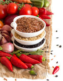 Red, black and unpolished organic rice and vegetables Royalty Free Stock Images