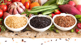 Red, black and unpolished organic rice and vegetables Stock Photography
