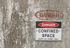 Red, black and white Danger, Confined Space warning sign. With text area stock photo