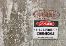 Red, black and white Danger, Hazardous Chemicals warning sign Stock Photo