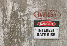Red, black and white Danger, Interest Rate Rise warning sign Stock Image