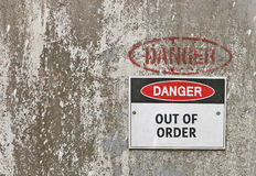 Red, black and white Danger, Out of Order warning sign. On industrial background Royalty Free Stock Photo