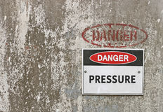 Red, black and white Danger, Pressure warning sign Stock Photography