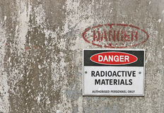 Red, black and white Danger, Radioactive Materials warning sign Royalty Free Stock Photos