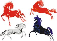 Red, black and white horses Stock Photo