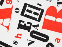 Red-black-white letters mixture. Mix of red, black and white letters scattered over white background - typographic graphic design fonts Stock Photo