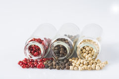 Red, black and white pepper in glass jars Stock Photo