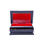 Red and black wood box. Old red and black jewellery box isolated against a white background Royalty Free Stock Photography