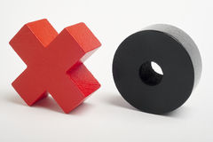 Red and black wooden pieces. Turn on, turn off symbol. Horizontal Royalty Free Stock Photography