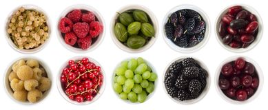 Red, black, yellow and green food. Fruits and berries in bowl isolated on white. Sweet and juicy berry with copy space for text. R. Asberries, blackberries Stock Photography