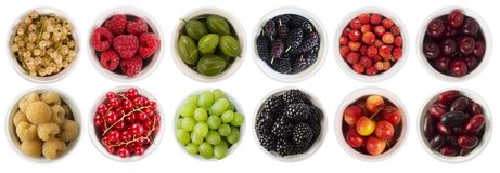 Red, black, yellow and green food. Fruits and berries in bowl isolated on white. Sweet and juicy berry with copy space for text. R. Asberries, blackberries Royalty Free Stock Photos