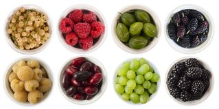 Red, black, yellow and green food. Fruits and berries in bowl isolated on white. Sweet and juicy berry with copy space for text. R. Red, black, yellow and green Stock Images