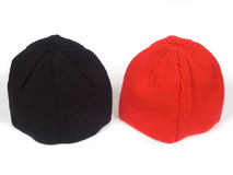 Red and blackenning atheletic hats. On white background Stock Photography