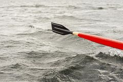 Red and black wooden paddle rowing boat in the lake. royalty free stock photo
