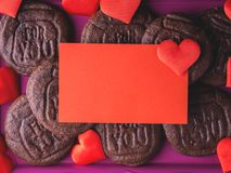 Red blank card, hearts and cookies. Spelling For You. Romantic home made gift Stock Photography