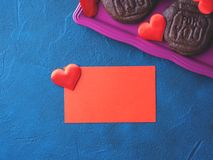 Red blank card, hearts and cookies. Spelling For You. Romantic home made gift Royalty Free Stock Photo