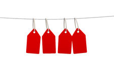 Red blank labels or tag hanging from a string line Stock Photography