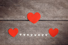 Red blank paper note with heart shape on grunge wooden backgroun Stock Photo
