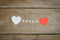 Red blank paper note with heart shape on grunge wooden backgroun Stock Photos