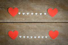 Red blank paper note with heart shape on grunge wooden backgroun Royalty Free Stock Image