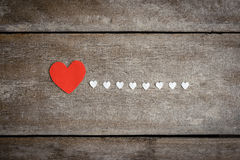 Red blank paper note with heart shape on grunge wooden backgroun Stock Photography