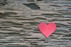 Red blank paper note with heart shape on grunge wooden backgroun. D Royalty Free Stock Image