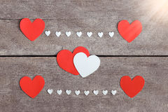 Red blank paper note with heart shape on grunge wooden background Stock Photo