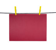 Red blank sheet on clothes-line for your notice Royalty Free Stock Image