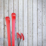 Red blank skis on wooden planks wall, winter background Stock Photo