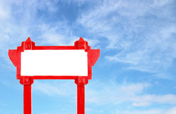 Red blank wooden sign with blue sky Stock Images